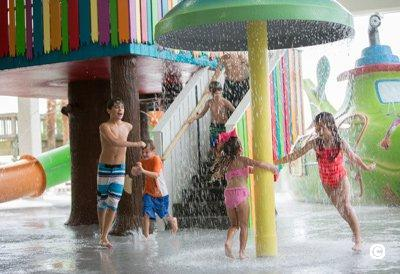kids under the water umbrella at saltys splash house
