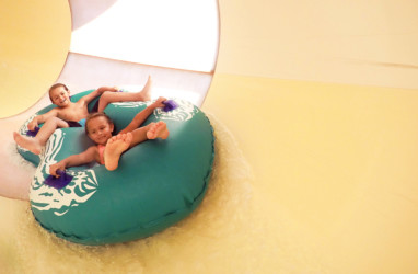 Brother and sister in the tube slide