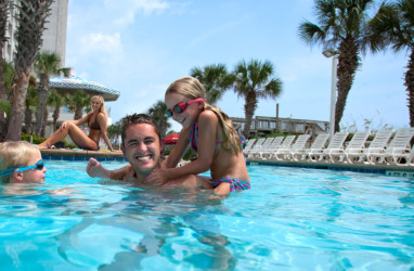 Family playing in a Myrtle Beach pool