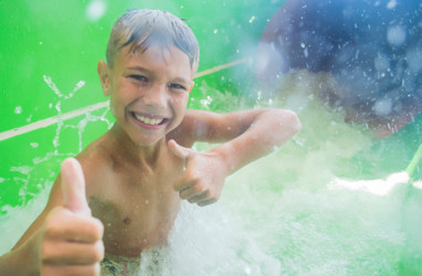 Boy in waterslide